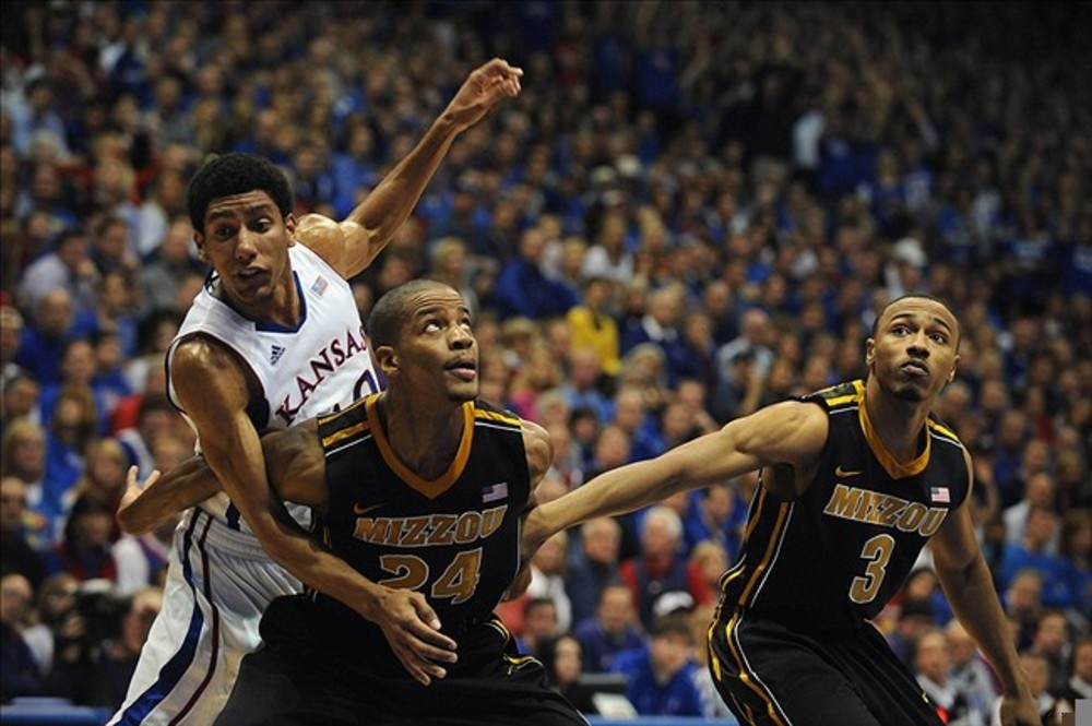 Feb 25, 2012; Lawrence, KS, USA; Kansas Jayhawks guard Kevin Young (40) is blocked by Missouri Tigers guards Kim English (24) and Matt Pressey (3) in the first half at Allen Fieldhouse. Mandatory Credit: John Rieger-US PRESSWIRE