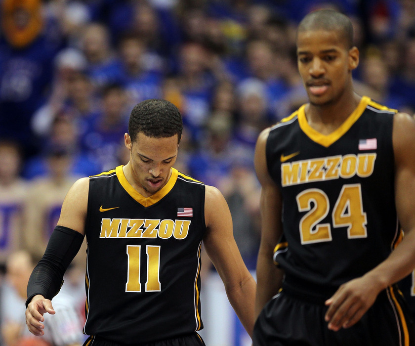 LAWRENCE, KS - FEBRUARY 25:  Michael Dixon #11 and Kim English #24 of the Missouri Tigers react during the game against the Kansas Jayhawks on February 25, 2012 at Allen Fieldhouse in Lawrence, Kansas.  (Photo by Jamie Squire/Getty Images)