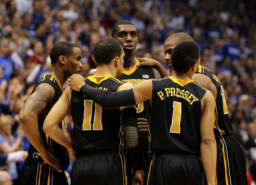 LAWRENCE, KS - FEBRUARY 25:  The Missouri Tigers huddle as the game against the Kansas Jayhawks goes into overtime on February 25, 2012 at Allen Fieldhouse in Lawrence, Kansas.  (Photo by Jamie Squire/Getty Images)