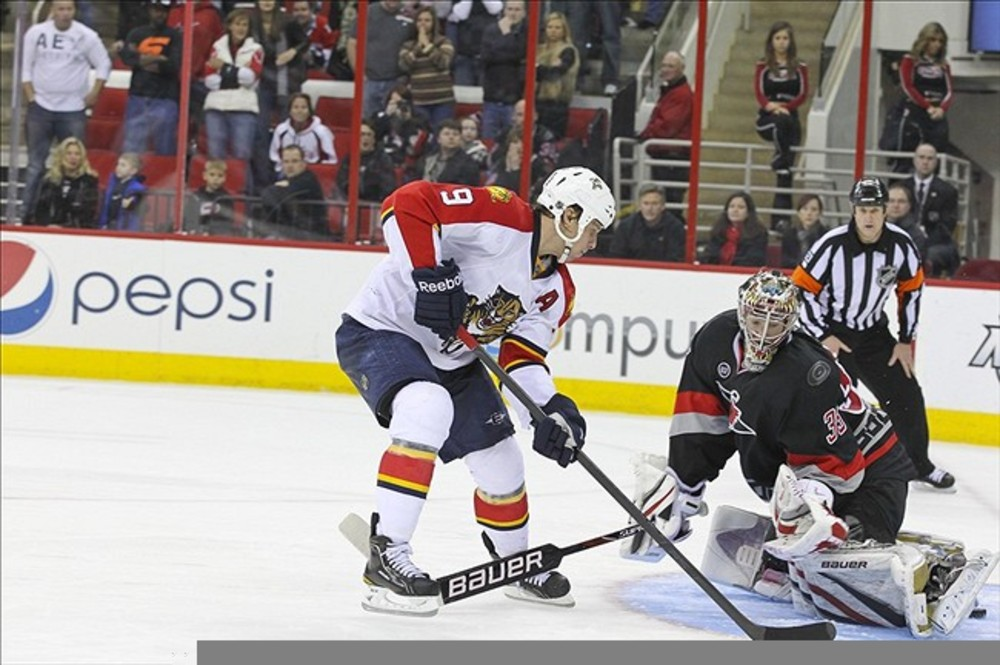 Florida's Stephen Weiss scores the game-winner in the shootout Saturday night, propelling the division-leading Panthers to a 3-2 victory over the Carolina Hurricanes.