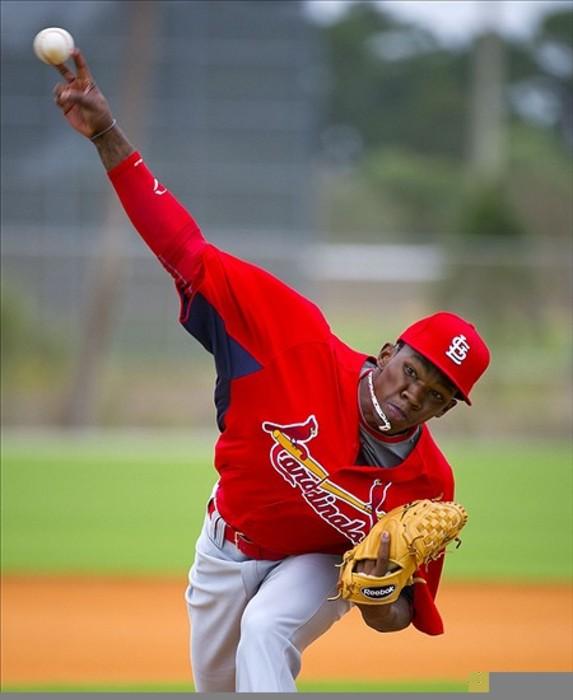 Feb 26, 2012; Jupiter, FL. USA; St. Louis Cardinals pitcher Tyrell Jenkins (29) delivers a pitch during workouts at Roger Dean Stadium. Mandatory Credit: Scott Rovak-US PRESSWIRE