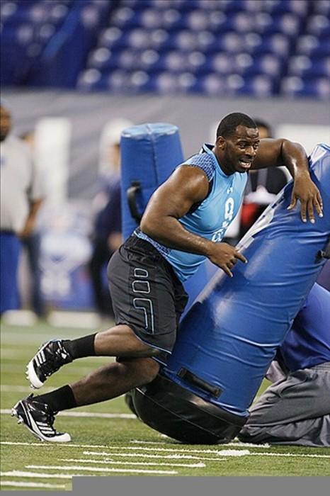 Feb 27, 2012; Indianapolis, IN, USA; North Carolina Tar Heels defensive lineman Quinton Coples hits the tackling dummy during the NFL Combine at Lucas Oil Stadium. Mandatory Credit: Brian Spurlock-US PRESSWIRE