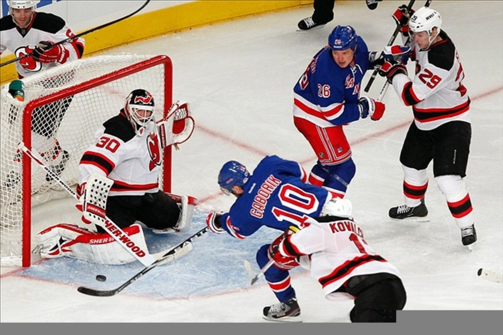 Feb. 27, 2012; New York, NY, USA; New York Rangers right wing Marian Gaborik (10) shoots on New Jersey Devils goalie Martin Brodeur (30) during the third period at Madison Square Garden. Rangers won 2-0. Debby Wong-US PRESSWIRE