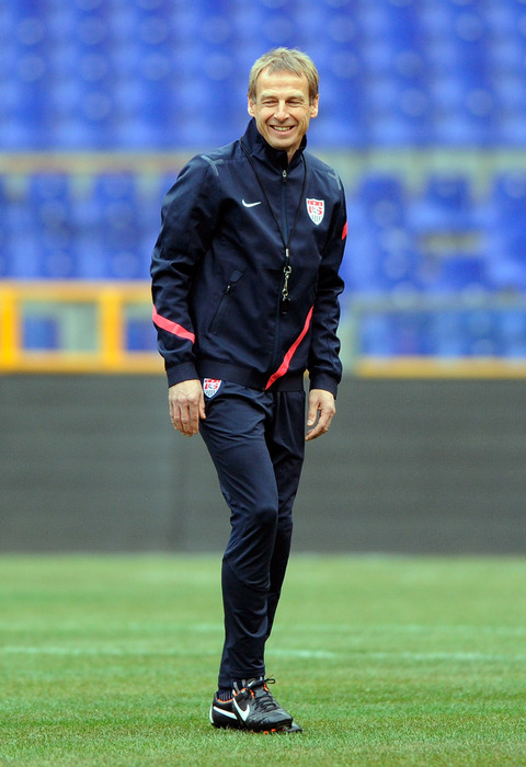 GENOA, ITALY - FEBRUARY 28:  USA head coach Jurgen Klinsmann smiles during a training session ahead of their international friendly against Italy at Luigi Ferraris Stadium on February 28, 2012 in Genoa, Italy.  (Photo by Claudio Villa/Getty Images)