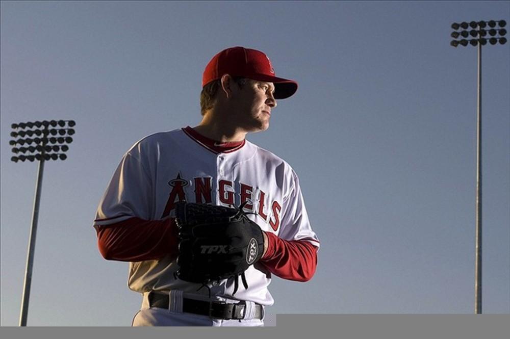 Feb 29, 2012; Tempe, AZ, USA; Los Angeles Angels relief pitcher Jason Isringhausen (35) during photo day at Tempe Diablo Stadium.  Mandatory Credit: Jake Roth-US PRESSWIRE