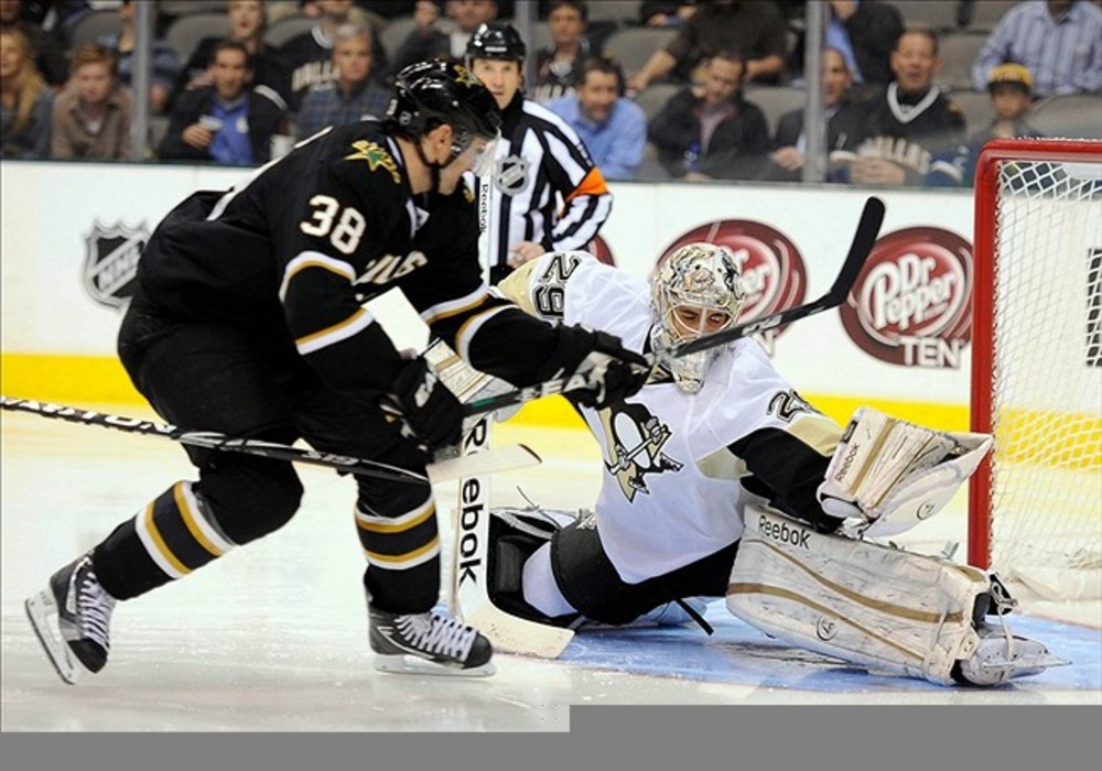 Feb 29, 2012; Dallas, TX, USA; Pittsburgh Penguins goalie Marc-Andre Fleury (29) makes a save on Dallas Stars center Vernon Fiddler (38) during the second period at the American Airlines Center. Mandatory Credit: Jerome Miron-US PRESSWIRE