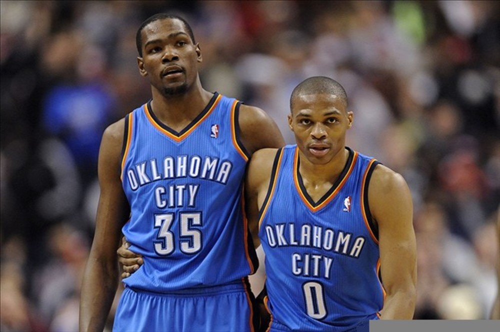Feb 29, 2012; Philadelphia, PA, USA; Oklahoma City Thunder forward Kevin Durant (35) and guard Russell Westbrook (0) during the second quarter against the Philadelphia 76ers at the Wells Fargo Center. Mandatory Credit: Howard Smith-US PRESSWIRE
