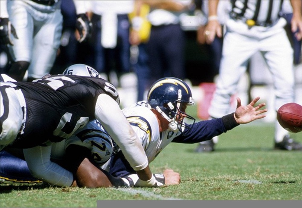 Sep 3, 2000; Oakland, CA, USA: FILE PHOTO; San Diego Chargers quarterback Ryan Leaf (16) fumbles against the Oakland Raiders at Oakland-Alameda Coliseum. Mandatory Credit: Peter Brouillet-US PRESSWIRE
