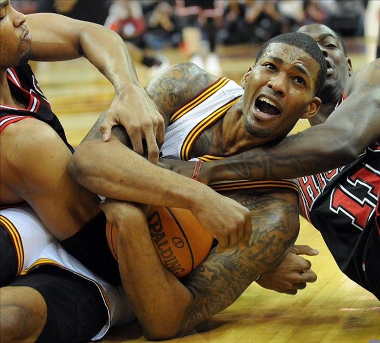 March 2, 2012; Cleveland, OH, USA: Cleveland Cavaliers small forward Alonzo Gee (33) and Chicago Bulls shooting guard Ronnie Brewer (11) go for a loose ball during the game at Quicken Loans Arena.  Mandatory Credit: Eric P. Mull-USPRESSWIRE