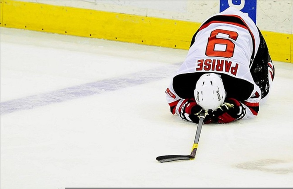 March 2, 2012;Washington D.C., USA; New Jersey Devils left wing Zach Parise (9) reacts after getting injured in the second period against the Washington Capitals at Verizon Center. Mandatory Credit: Evan Habeeb-US PRESSWIRE