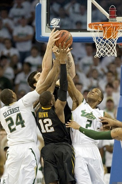 March 3, 2012; Tampa, FL, USA; Augustus Gilchrist (24) blocks a shot and hopes to avoid a whistle in Saturday's game at The Dali Museum Mandatory Credit: Jeff Griffith-US PRESSWIRE
