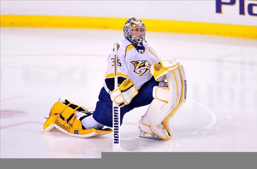 <em>Pekka Rinne casually stretches during another 40+ save performance.</em>