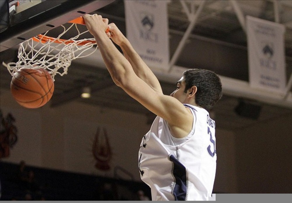 March 03, 2012; Houston, TX, USA; Rice Owls center Omar Oraby (34) dunks the ball in the first half against the Houston Cougars at Tudor Fieldhouse. Mandatory Credit: Troy Taormina-US PRESSWIRE