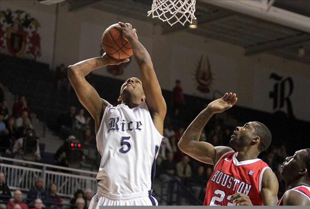 March 03, 2012; Houston, TX, USA; Rice Owls forward Emerson Herndon (5) attemtps to score in the first half against the Houston Cougars at Tudor Fieldhouse. Mandatory Credit: Troy Taormina-US PRESSWIRE