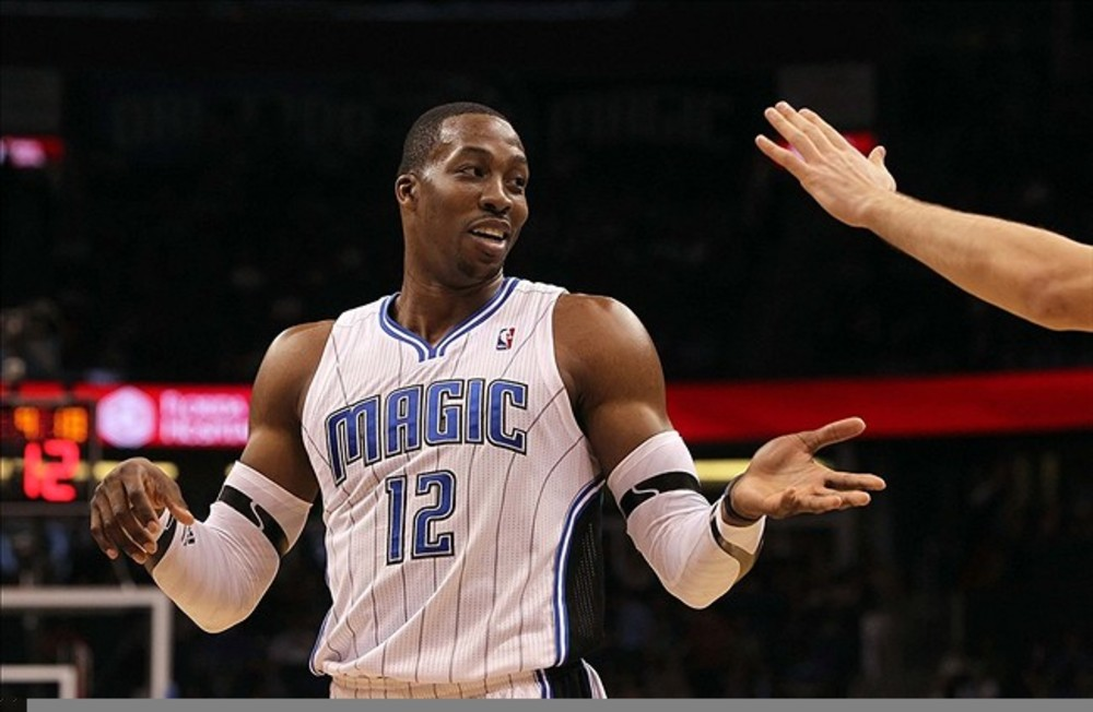 March 3, 2012; Orlando FL, USA; Orlando Magic center Dwight Howard (12) high fives during the second half against the Milwaukee Bucks at Amway Center. Orlando Magic defeated the Milwaukee Bucks 111-98. Mandatory Credit: Kim Klement-US PRESSWIRE