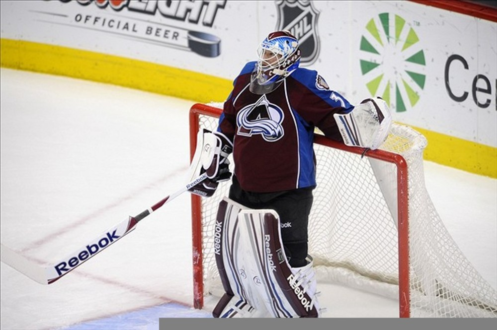 March 3 2012; Denver, CO, USA;Colorado Avalanche goalie Jean-Sebastien Giguere (35) reacts after giving up the second goal of the first period to the Pittsburgh Penguins at the Pepsi Center. Mandatory Credit: Ron Chenoy-US PRESSWIRE