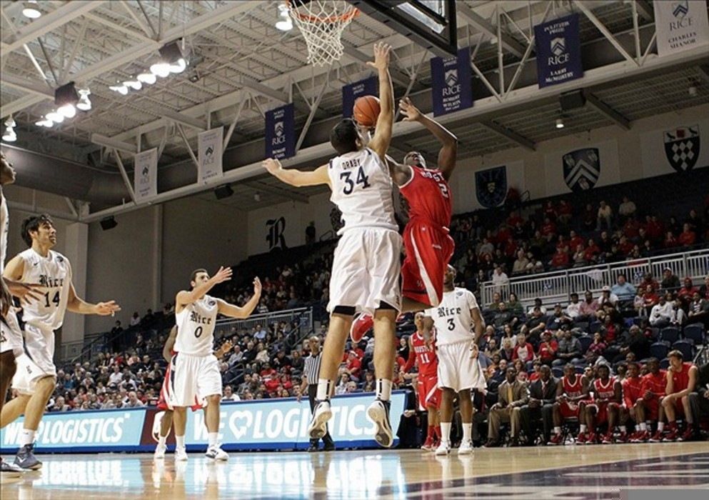 March 03, 2012; Houston, TX, USA; Houston Cougars forward Alandise Harris (2) attempts to score in the second half as Rice Owls center Omar Oraby (34) defends at Tudor Fieldhouse. Mandatory Credit: Troy Taormina-US PRESSWIRE