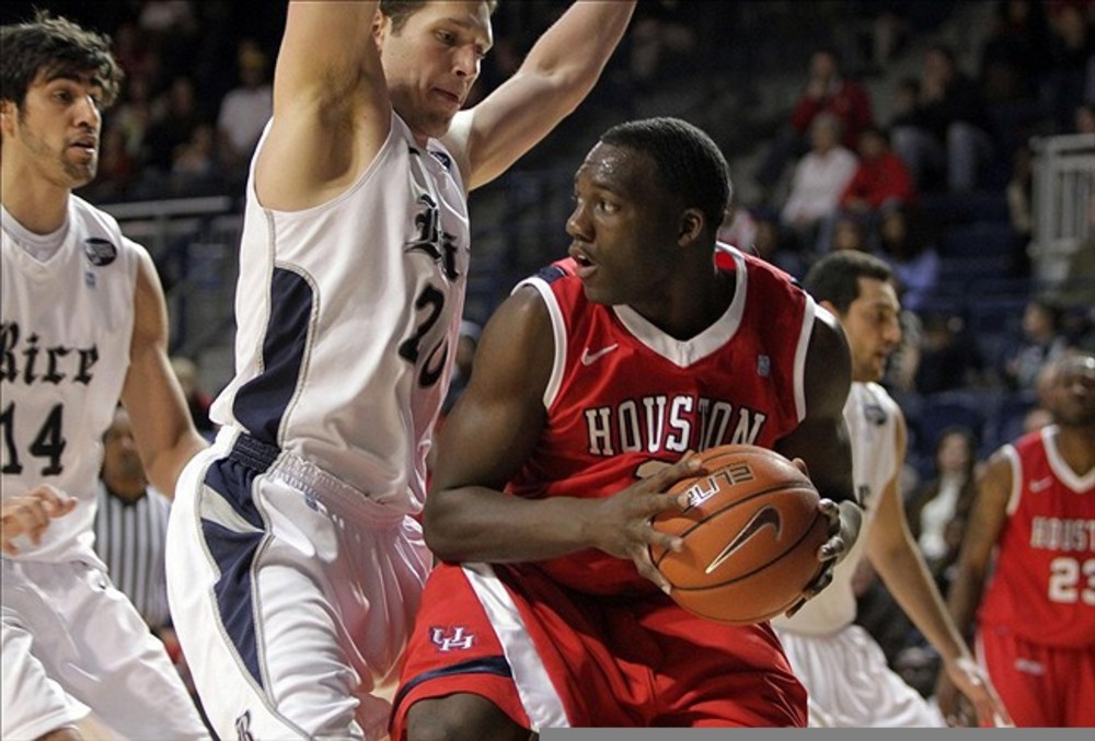 March 03, 2012; Houston, TX, USA; Houston Cougars forward Alandise Harris (2) attempts to drive the ball around a defender in the second half against the Rice Owls at Tudor Fieldhouse. Mandatory Credit: Troy Taormina-US PRESSWIRE