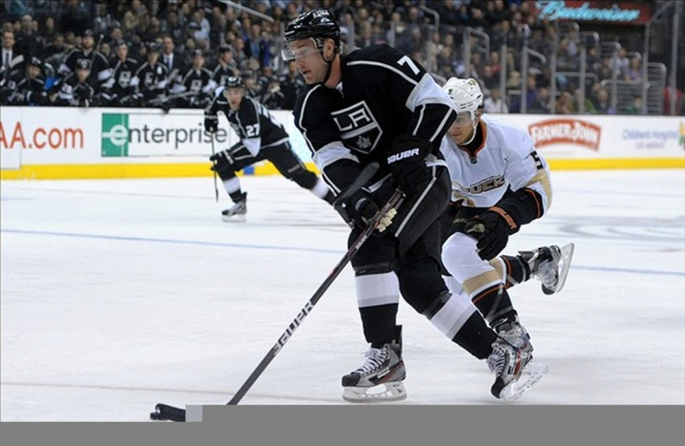 Mar 3, 2012; Los Angeles, CA, USA; Anaheim Ducks defenseman Luca Sbisa (5) defends Los Angeles Kings center Jeff Carter (77) as he skates with the puck in the first period at the Staples Center. Mandatory Credit: Kirby Lee/Image of Sport-US PRESSWIRE