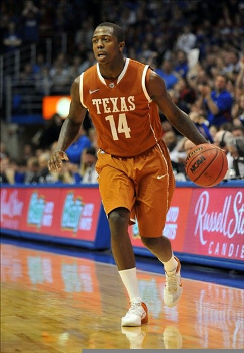 March 03, 2012; Lawrence, KS, USA; Texas Longhorns guard J'Covan Brown (14) dribbles the ball in the second half of the game against the Kansas Jayhawks at Allen Fieldhouse. Kansas won the game 73-63. Mandatory Credit: Denny Medley-US PRESSWIRE