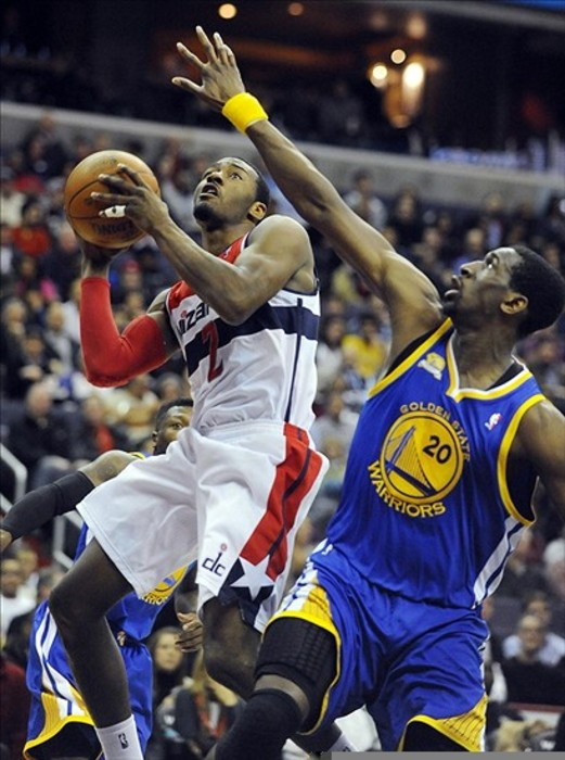 Mar 5, 2012; Washington, DC, USA; Washington Wizards guard John Wall (2) drives to the basket while defended by Golden State Warriors power forward Ekpe Udoh (20) during the first half at the Verizon Center. Mandatory Credit: Brad Mills-US PRESSWIRE