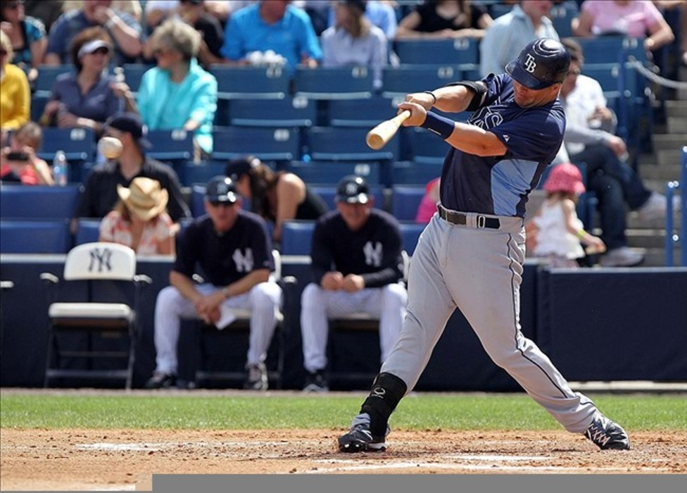 March 7, 2012; Tampa, FL, USA; Tampa Bay Rays catcher Stephen Vogt (26) hits a single in the fourth inning during spring training against the New York Yankees at George M. Steinbrenner Field. Mandatory Credit: Kim Klement-US PRESSWIRE