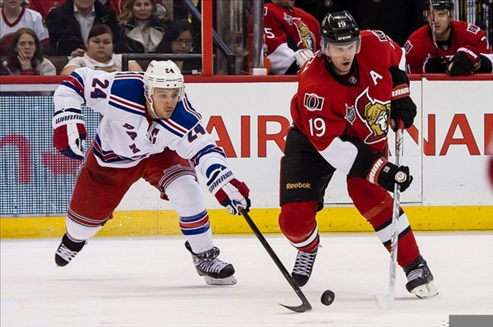 Mar 8, 2012; Ottawa, ON, CAN; New York Rangersright wing Ryan Callahan (24) and Ottawa Senators centre Jason Spezza (19) fight for the puck in the second period at Scotiabank Place. Mandatory Credit: Marc DesRosiers-US PRESSWIRE