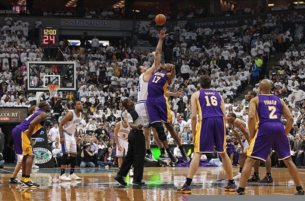 Mar 9, 2012; Minneapolis, MN, USA: Los Angeles Lakers center Andrew Bynum (17) and Minnesota Timberwolves center Nikola Pekovic (14) jump for the opening tip at Target Center. Mandatory Credit: Jesse Johnson-US PRESSWIRE