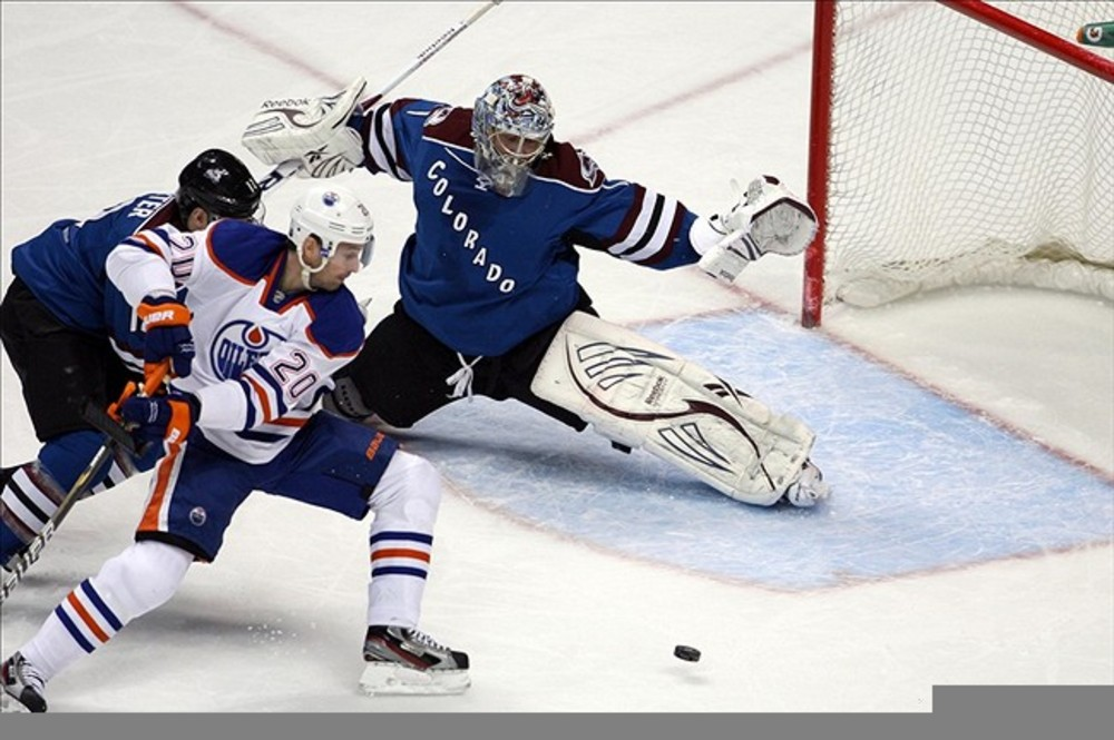 March 10, 2012; Denver, CO, USA; Colorado Avalanche goalie Semyon Varlamov (1) blocks a shot from Edmonton Oilers  center Eric Belanger (20) during the first period at the Pepsi Center.  Mandatory Credit: Chris Humphreys-US PRESSWIRE
