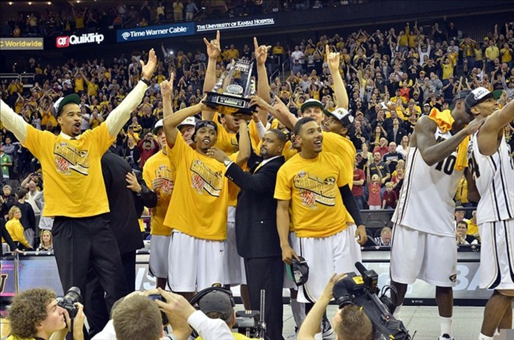March 10, 2012; Kansas City, MO, USA; The Missouri Tigers and head coach Frank Haith are presented the trophy after winning the 2012 Big 12 Tournament at the Sprint Center. Missouri won 90 - 75. Mandatory Credit: Denny Medley-US PRESSWIRE