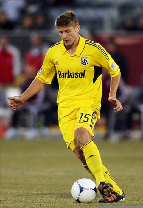 March 10, 2012; Denver, CO, USA;  Columbus Crew midfielder Kirk Urso (15) controls the ball during the second half against the Colorado Rapids at the Dick's Sporting Goods Park.  Mandatory Credit: Chris Humphreys-US PRESSWIRE