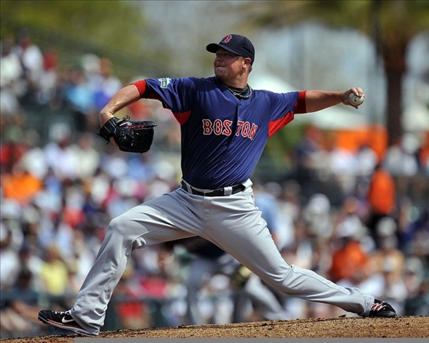 Boston Red Sox starting pitcher Jon Lester throws in the first inning against the Baltimore Orioles at Ed Smith Stadium. The Red Sox defeated the Orioles 6 - 1. Mandatory Credit: Joy R. Absalon-US PRESSWIRE