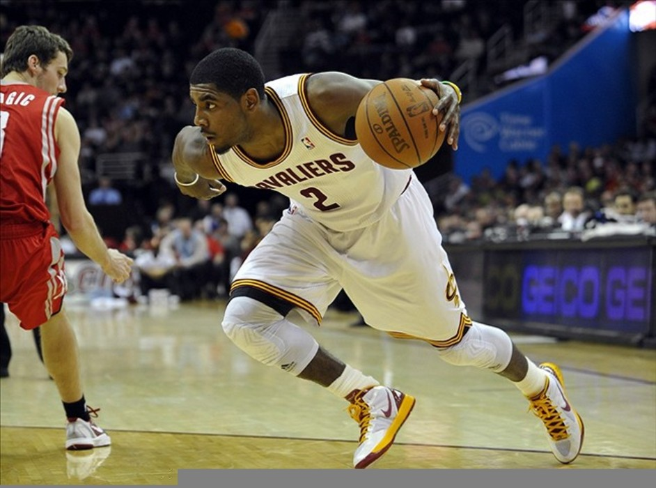 Feb 28, 2012; Cleveland, OH, USA; Cleveland Cavaliers point guard Kyrie Irving (2) loses Houston Rockets point guard Goran Dragic (3) in the fourth quarter at Quicken Loans Arena. Mandatory Credit: David Richard-US PRESSWIRE