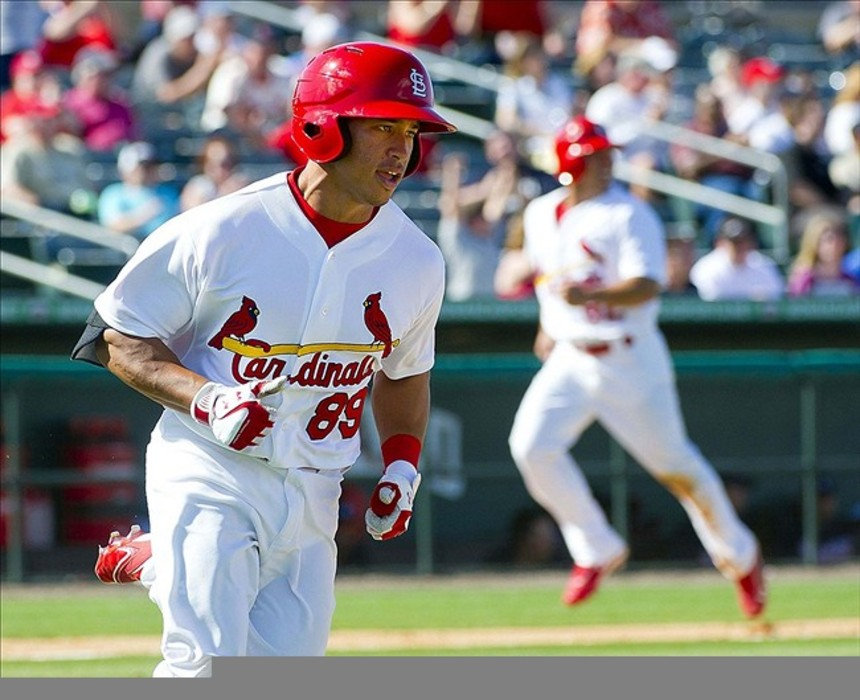 St. Louis Cardinals second baseman Kolten Wong (89) heads to first base with a game winning RBI single against the Atlanta Braves at Roger Dean Stadium. The Cardinals defeated the Braves 5-4. Mandatory Credit: Scott Rovak-US PRESSWIRE