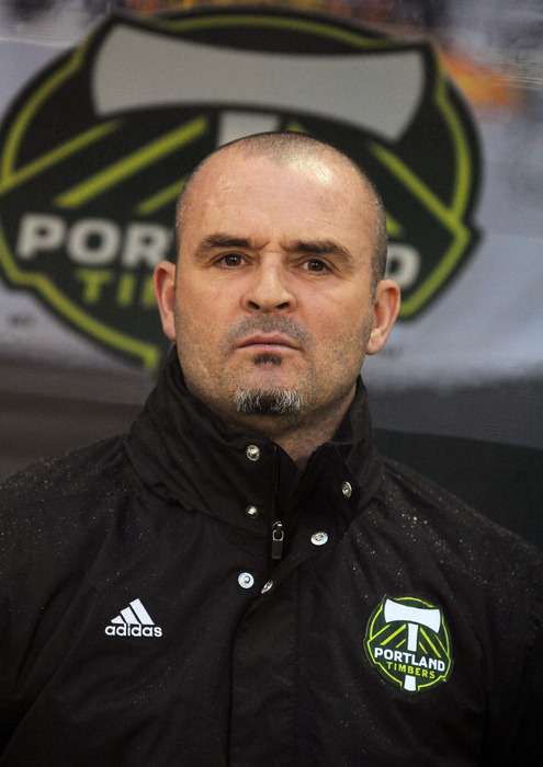 PORTLAND, OR - MARCH 12: Head coach John Spencer of the Portland Timbers looks on from the bench before the start of the game against the Philadelphia Union at JELD-WEN Field on March 12, 2012 in Portland, Oregon. (Photo by Steve Dykes/Getty Images)