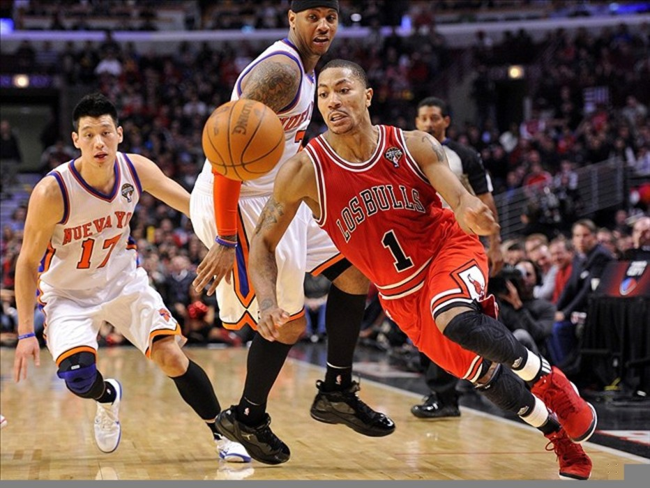 Mar 12, 2012; Chicago, IL, USA; Chicago Bulls point guard Derrick Rose (1) dribbles the ball against the New York Knicks during the second half at the United Center. The Bulls defeat the Knicks 104-99.  Mandatory Credit: Mike DiNovo-US PRESSWIRE