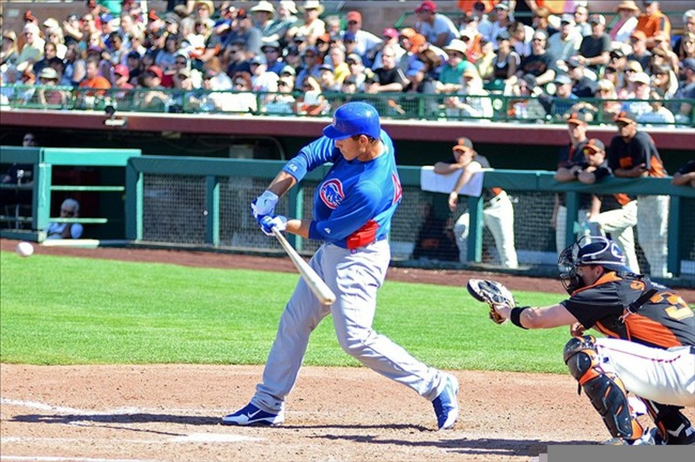 Mar 13, 2012; Scottsdale, AZ, USA; Chicago Cubs first baseman Anthony Rizzo (44) hits a solo home run during the seventh inning against the San Francisco Giants at Scottsdale Stadium.  Mandatory Credit: Jake Roth-US PRESSWIRE