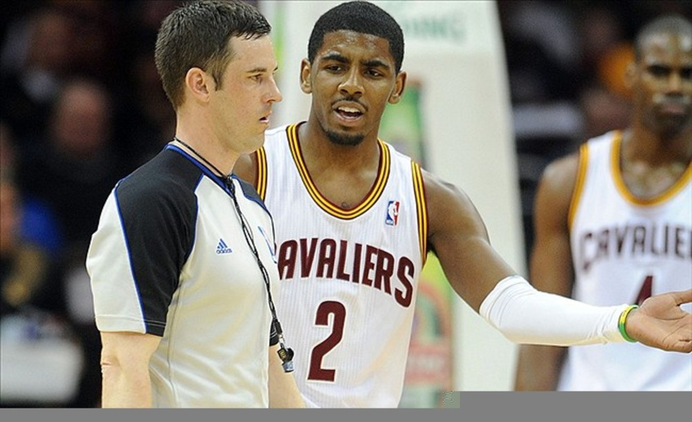 March 13, 2012; Cleveland, OH, USA: Cleveland Cavaliers point guard Kyrie Irving (2) talks to referee Kevin Scott during the game against the Toronto Raptors at Quicken Loans Arena.  Mandatory Credit: Eric P. Mull-USPRESSWIRE
