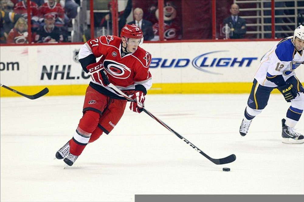 March 15, 2012; Raleigh, NC, USA; Carolina Hurricanes left wing Drayson Bowman (21) carries the puck against the St. Louis Blues at the PNC center. The Hurricanes defeated the Blues 2-0. Mandatory Credit: James Guillory-US PRESSWIRE