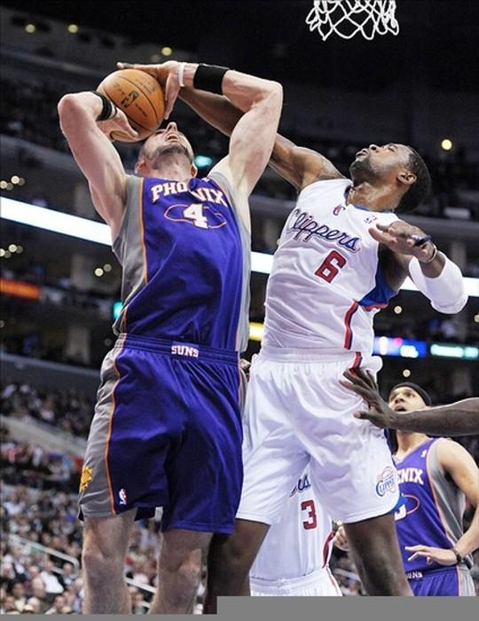 Mar 15, 2012, Los Angeles, CA, USA; Los Angeles Clippers center DeAndre Jordan (6) blocks a shot by Phoenix Suns center Marcin Gorat (4) at Staples Center. Mandatory Credit: Kirby Lee/Image of Sport-US PRESSWIRE
