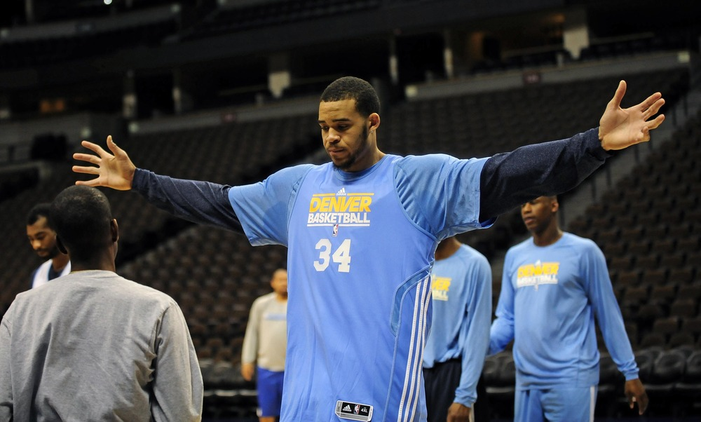March 19, 2012; Denver, CO, USA; Denver Nuggets center JaVale McGee (34) works out on the court during a walk through before the start of a press conference at the Pepsi Center. Mandatory Credit: Ron Chenoy-US PRESSWIRE