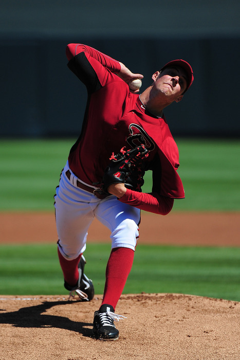 March 20, 2012; Scottsdale, AZ, USA; Arizona Diamondbacks starting pitcher Trevor Bauer (61) delivers a pitch during the first inning against the San Francisco Giants at Salt River Fields. Mandatory Credit: Kyle Terada-US PRESSWIRE