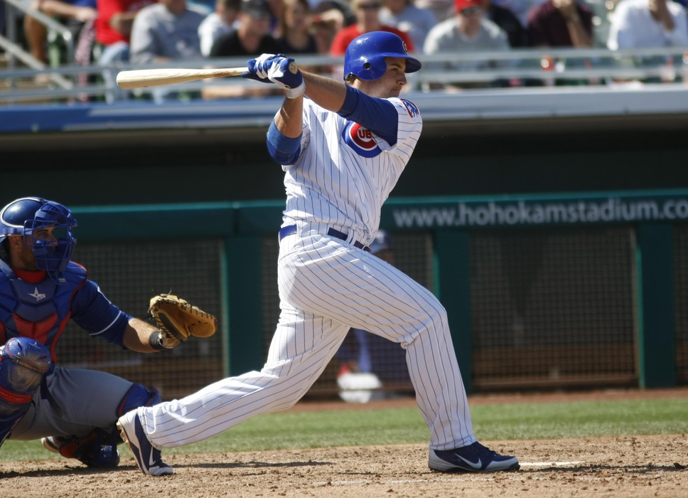 March 20, 2012; Mesa, AZ, USA; Chicago Cubs first baseman Anthony Rizzo (44) singles in the fourth inning against the Texas Rangers at HoHoKam Park.  Mandatory Credit: Rick Scuteri-US PRESSWIRE