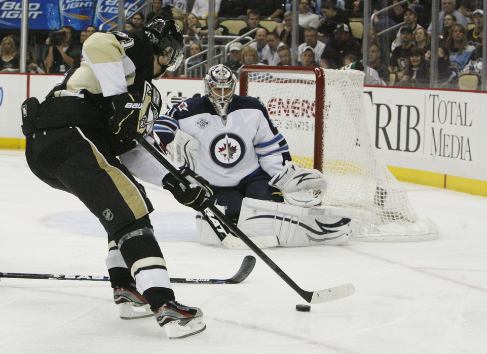 Mar 20, 2012; Pittsburgh, PA, USA; Pittsburgh Penguins center Evgeni Malkin (71) skates in against Winnipeg Jets goalie Ondrej Pavelec (31) during the second period at the CONSOL Energy Center. Mandatory Credit: Charles LeClaire-US PRESSWIRE