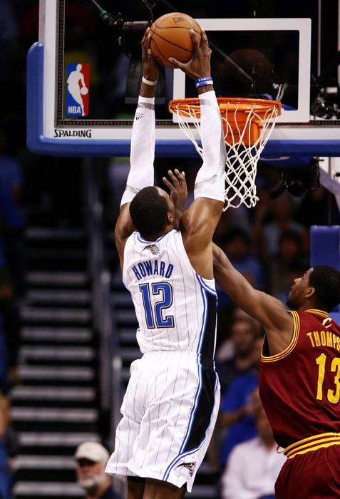 Mar 23, 2012; Orlando, FL, USA; Orlando Magic center Dwight Howard (12) dunks over Cleveland Cavaliers forward Tristan Thompson (13) during the first quarter at Amway Center. Mandatory Credit: Douglas Jones-US PRESSWIRE