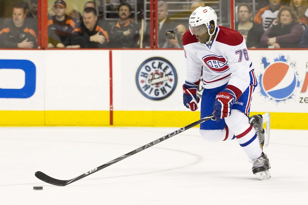 Mar 24, 2012; Philadelphia, PA, USA; Montreal Canadiens defenseman P.K. Subban (76) skates the puck up the ice against the Philadelphia Flyers during the 2nd period at the Wells Fargo Center.  Mandatory Credit: Christopher Szagola-US PRESSWIRE