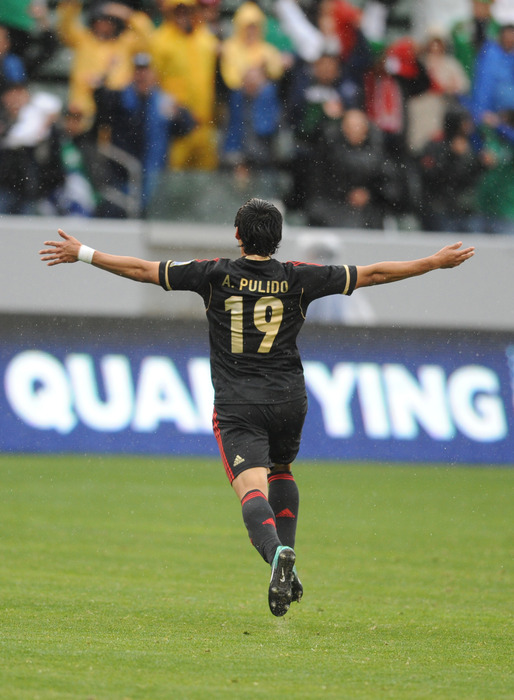 Mar 25, 2012; Carson, CA, USA; Mexico player Alan Pulido (19) celebrates after scoring a goal against Honduras during the first half of CONCACAF Olympic Qualifying at the Home Depot Center. Mandatory Credit: Kelvin Kuo-US PRESSWIRE