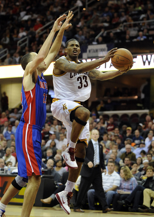 Mar 28, 2012; Cleveland, OH, USA; Cleveland Cavaliers small forward Alonzo Gee (33) shoots around Detroit Pistons small forward Tayshaun Prince (22) in the third quarter at Quicken Loans Arena. Mandatory Credit: David Richard-US PRESSWIRE
