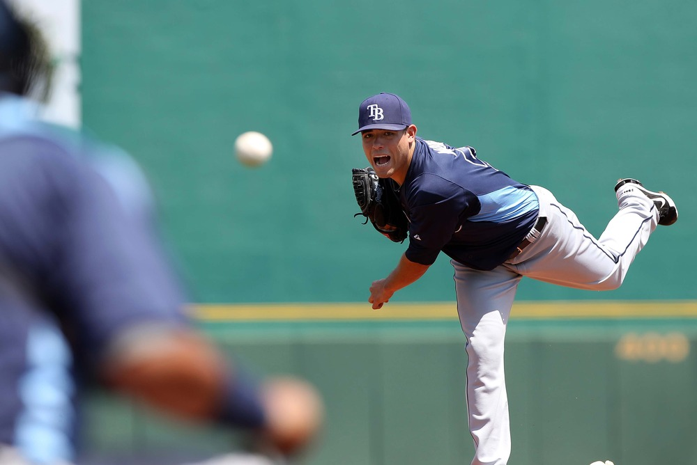 March 30, 2012; Bradenton, FL, USA; Tampa Bay Rays starting pitcher Matt Moore (55) throws a pitch in the first inning against the Pittsburgh Pirates at McKechnie Field.  Mandatory Credit: Kim Klement-US PRESSWIRE