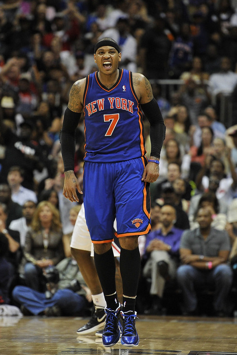Mar 30, 2012; Atlanta, GA, USA; New York Knicks small forward Carmelo Anthony (7) reacts to hitting a shot against the Atlanta Hawks during the second half at Philips Arena. The Hawks won 100-90. Mandatory Credit: Paul Abell-US PRESSWIRE